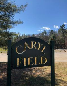 wooden outdoor sign reading caryl field