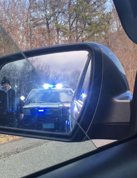 Officer reflection on a review mirror
